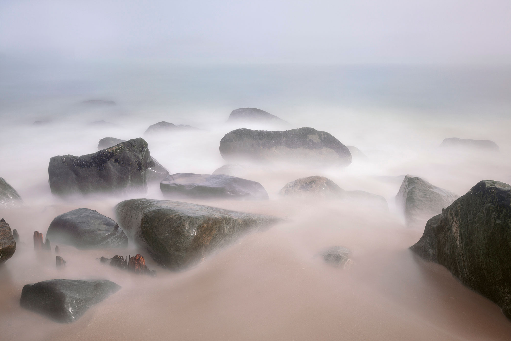 Ocean mist over rocks at Sandy Hook Beach New Jersey-Mist